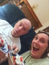 Dad and Lisa enjoy strawberry dessert